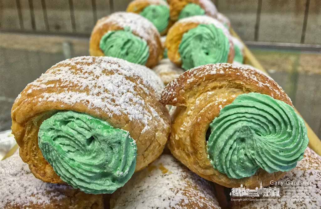 Cream horns with green filling sit in the display case at Schneider's Bakery in Uptown Westerville as an invitation to celebrate St. Patrick's Day Friday. My Final Photo for March 15, 2017.