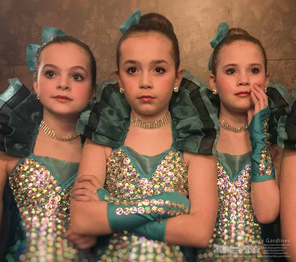 A trio of dancers stand in the wings watching younger dancer on stage during a performance by Generations Dancers foe second graders at Hanby Elementary. My Final Photo for March 10, 2017.