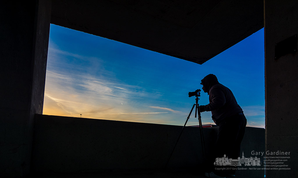 A photographer adjusts his tripod getting ready to photograph the sunset over Hoover Dam. My Final Photo for March 11, 2017.