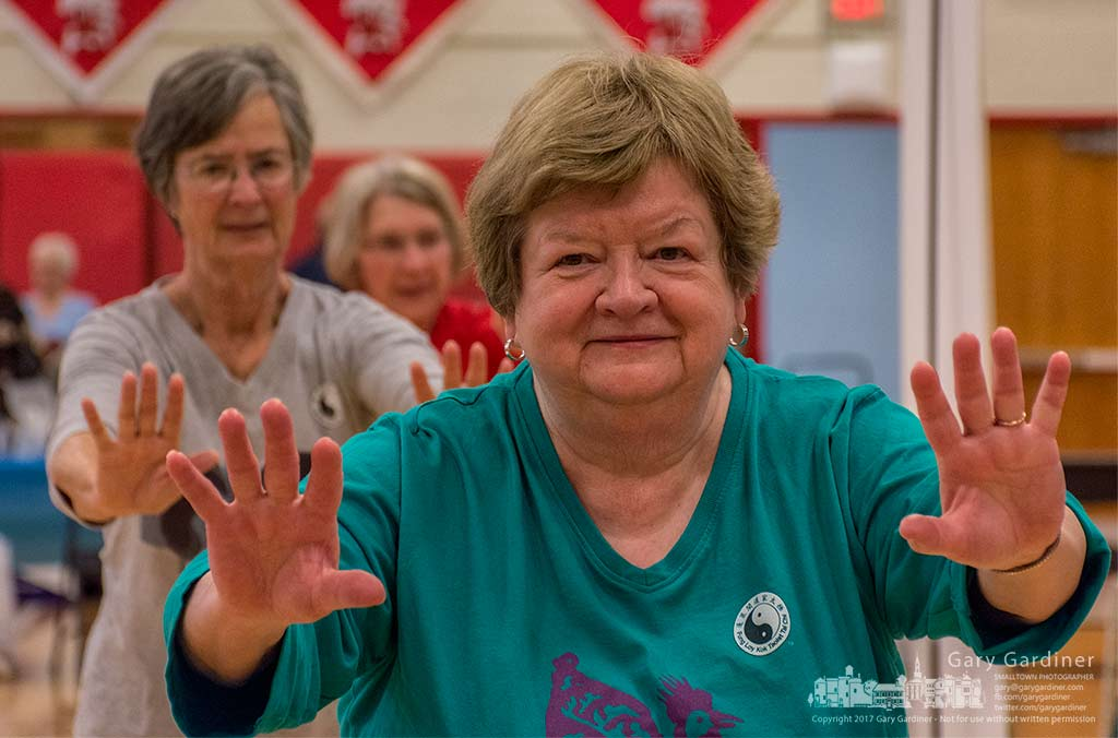 Sue Phillips leads a group of seniors performing Tai Chi during the Serving Out Seniors at Westerville South. My Final Photo for March 25, 2017.