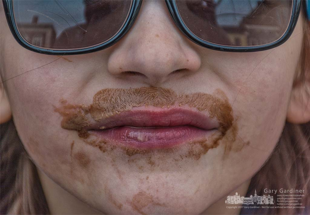 A young girl wears a chocolate mustache and beard after finishing a cone of chocolate ice cream in Uptown. My Final Photo for March 28, 2017.