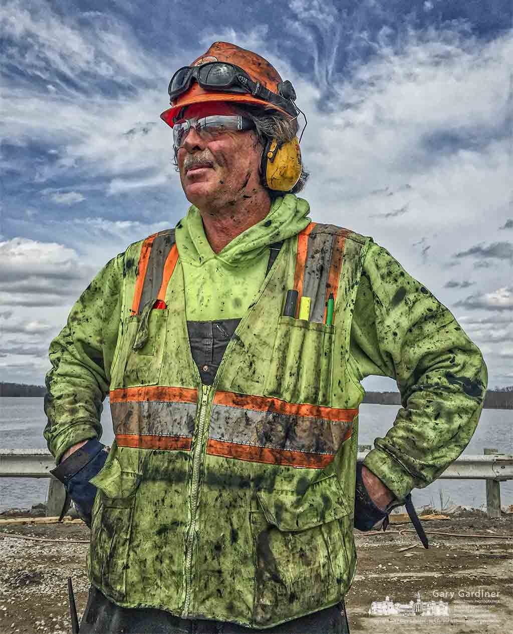 A construction worker coated with grease from the hammer used to drive pilings into Hoover Reservoir for the new bridge pauses for a photo after a brief break in the afternoon. My Final Photo for March 27, 2017