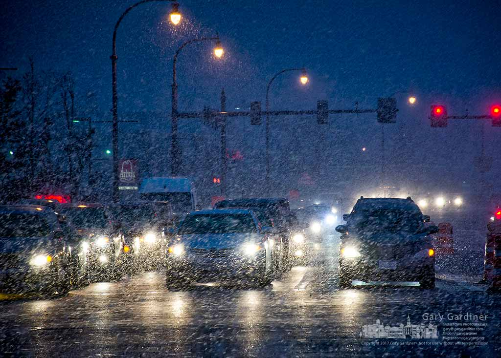 Commuters wait in a snow squall at the traffic signal at State and Schrock as a traditional winter returns to central Ohio. My Final Photo for March 2, 2017.