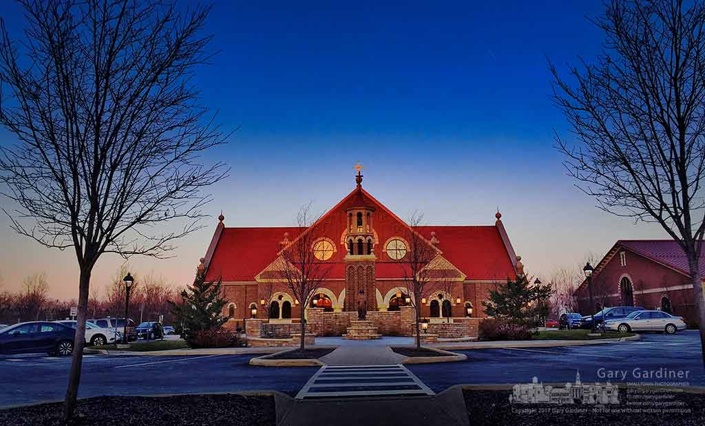 The warm glow of sunrise strikes the front doors of St. Paul the Apostle Catholic Church in Westerville, Ohio before the first Mass of the day. My Final Photo for March 5, 2017.