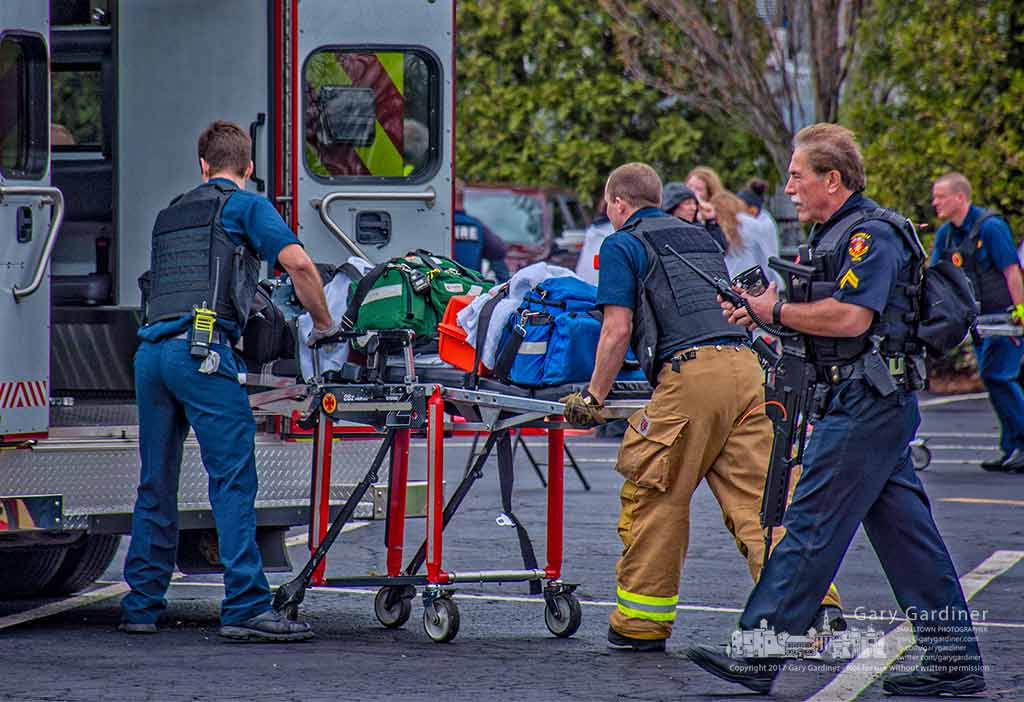 Westerville police and fire fighters pack up their gear after completing an early morning large scale disaster training at The Point. Otterbein's STEAM center. My Final Photo for April 4, 2017.