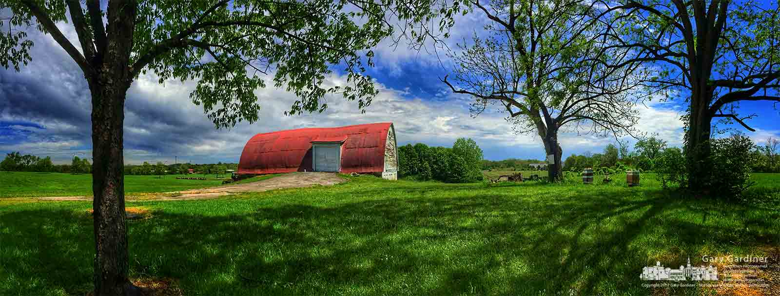 The noonday sun deepens the colors of the Braun Farm's red barn, green fields, and blue sky after a cloudy morning and before a much cooler afternoon freeze. My Final Photo for May 1, 2017.