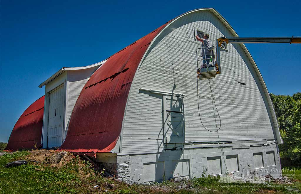 The barn on the Braun Farm at Cleveland and Cooper gets a fresh coat of paint. My Final Photo for May 8, 2017.