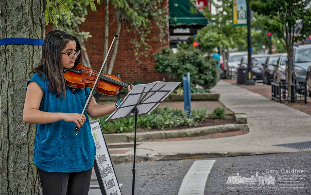A violinist plays a Vivaldi selection at the entrance to the Uptown Farmers Market greeting hungry shoppers with music. My Final Photo for May 10, 2017.