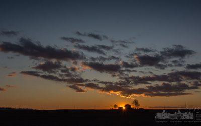 Sunset over the winter farm