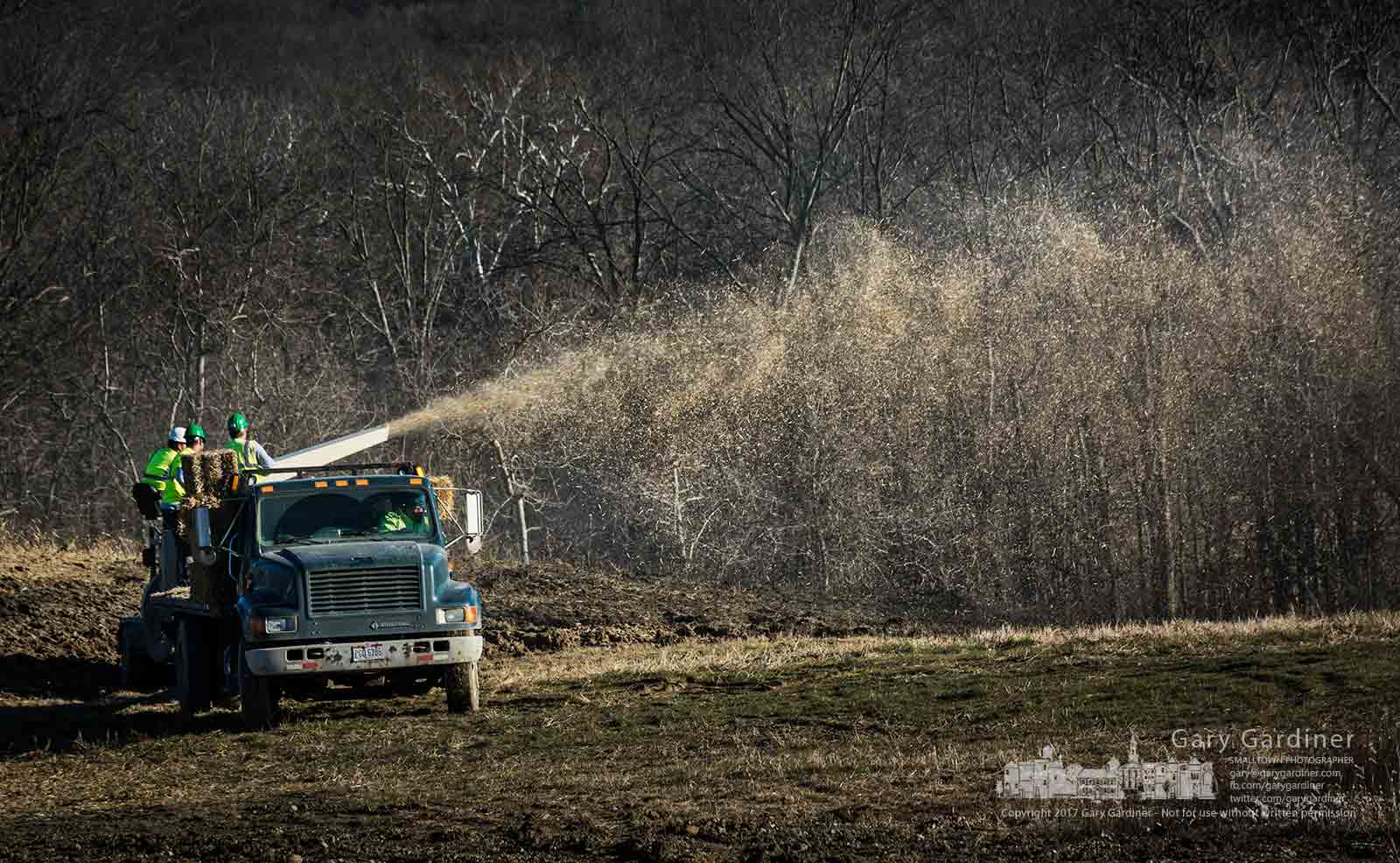 A landscaping crew blows straw across freshly seeded fields along Sunbury Road near Central College after a work crew leveled the ground in anticipation of future construction. My Final Photo for Dec. 21, 2017.