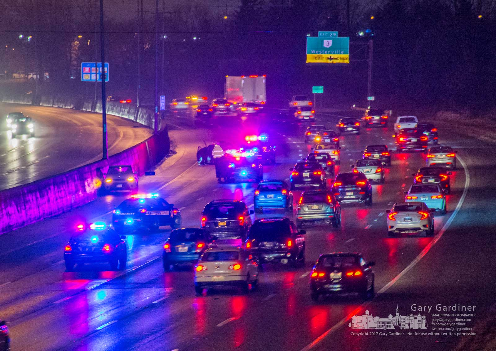 Blendon Police direct traffic around a two-vehicle car crash on I-270 between the Dempsey Road bridge and Westerville Road. My final Photo for Dec. 18, 2017.
