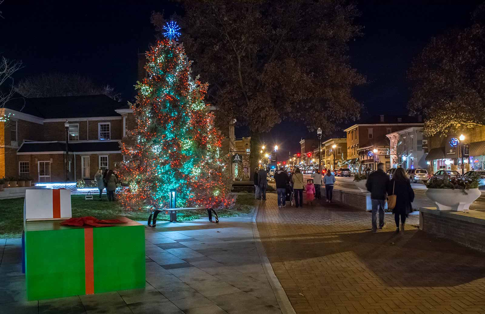 The last of the crowd leaves the new courtyard in front of city hall after the holiday tree lighting ceremony. My Final Photo for Dec. 1, 2017.