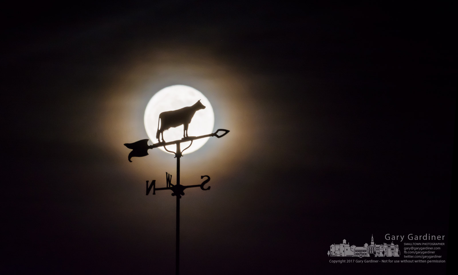 The bovine weather vane at the top of US Bank building in Uptown Westerville is silhouetted against the full moon shining through a thin cloud layer Sunday night. My Final Photo for Dec. 3, 2017.