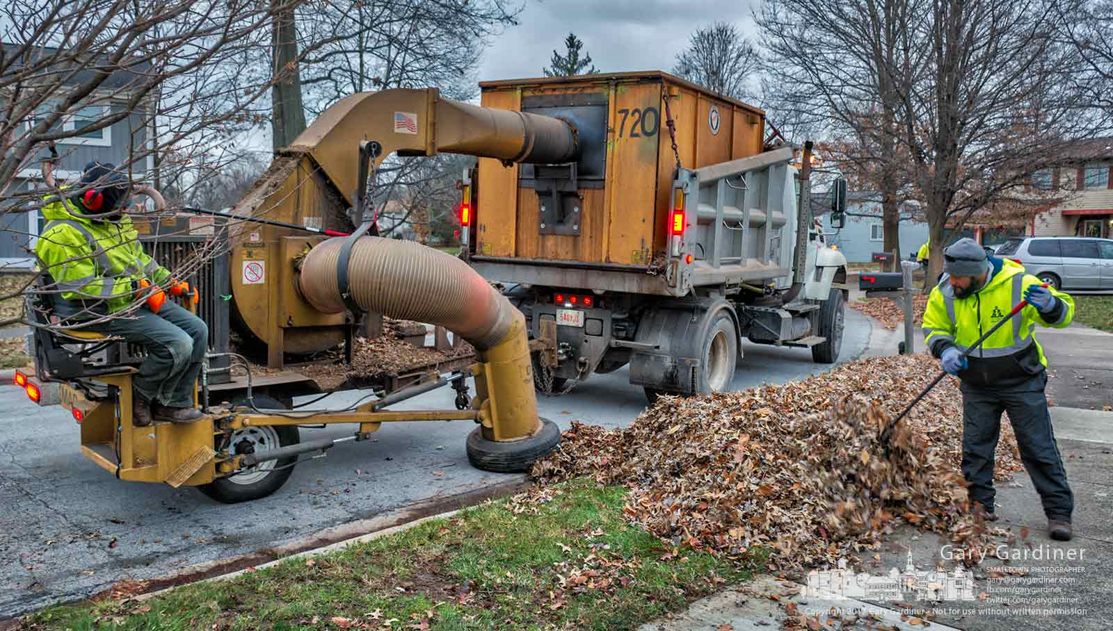 Westerville crew runs one of the city leaf vacuums along a neighborhood street clearing away collections of leaves raked to the curb. My Final Photo for Dec. 7, 2017.