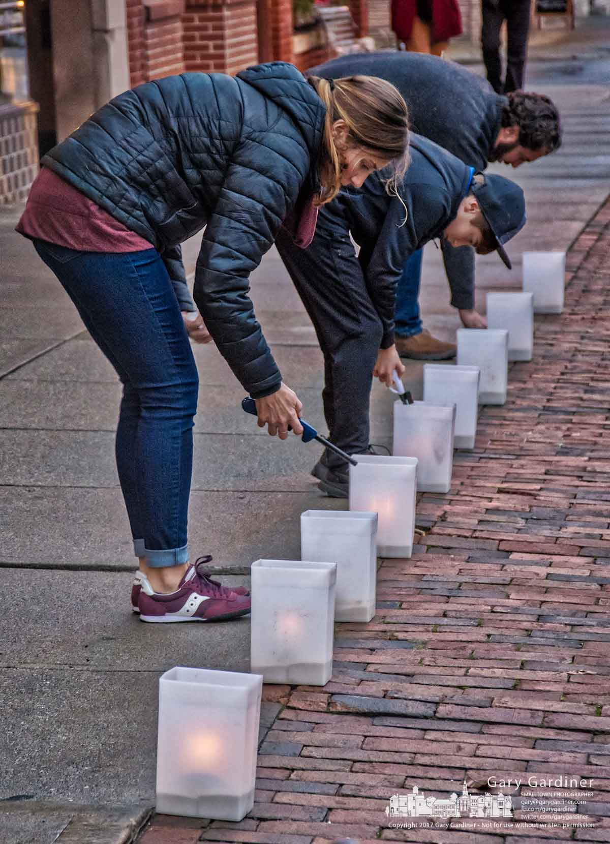 Three of the Qualls family light luminaries on the sidewalks in Uptown Westerville on the last Friday night before Christmas. My Final Photo for Dec. 22, 2017.