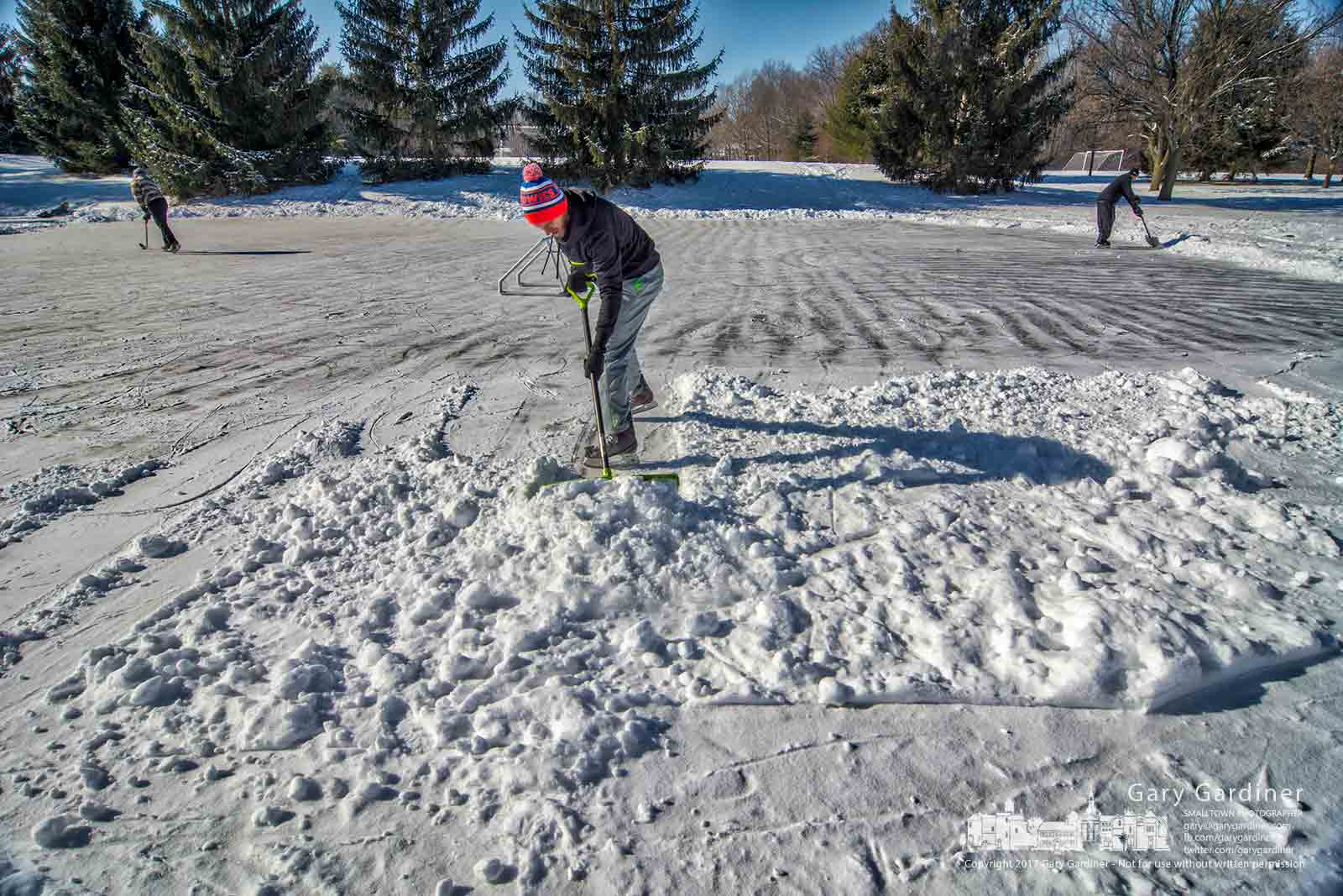 A skater clears snow from the ice skating rink now open at Metzger Park in Westerville. My Final Photo for Dec. 31, 2017.