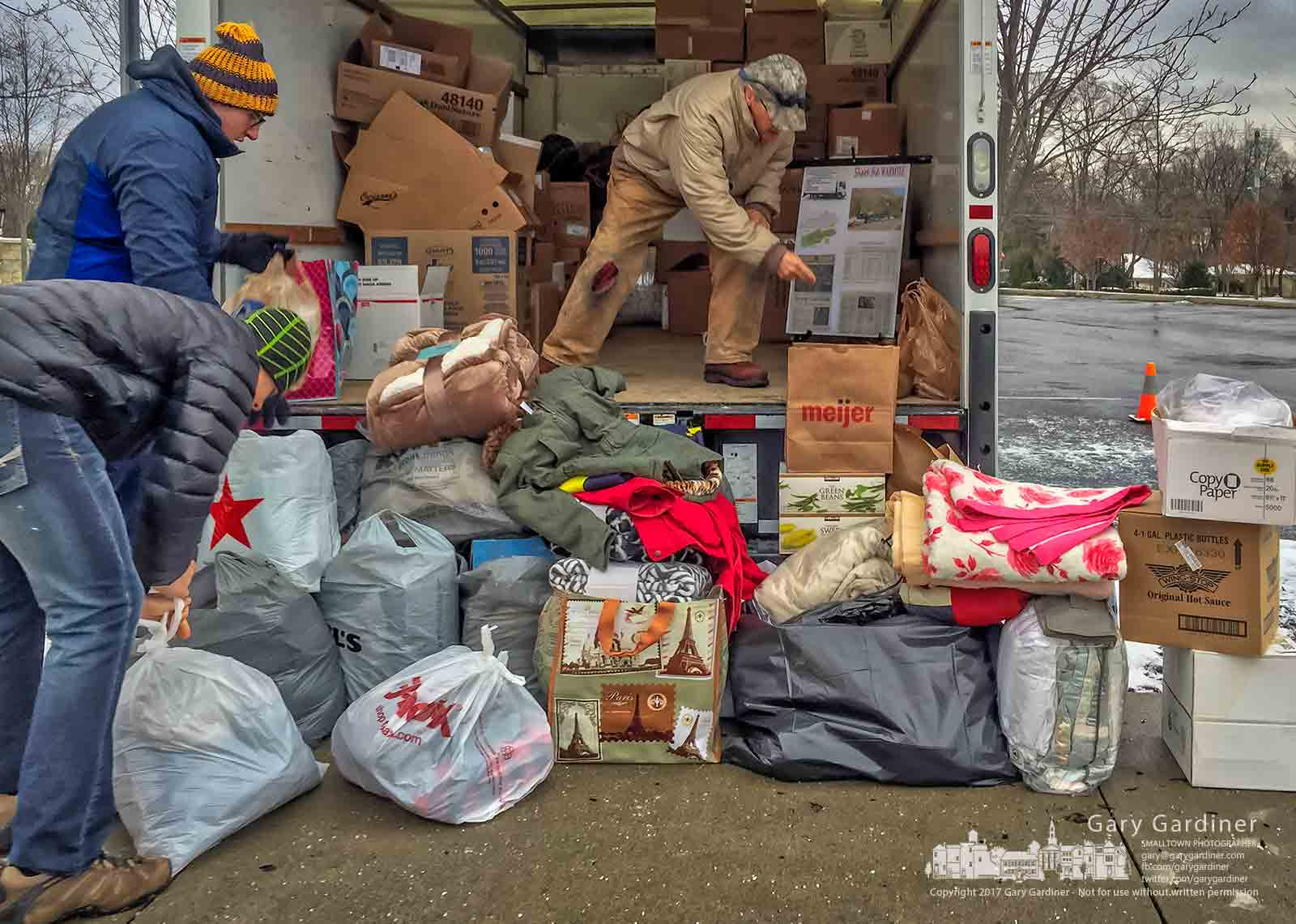 On a frigid winter morning volunteers gather coats and blankets donated to the St. Vincent dePaul Society at St. Paul Catholic Church Sunday morning. My Final Photo for Dec. 10, 2017.