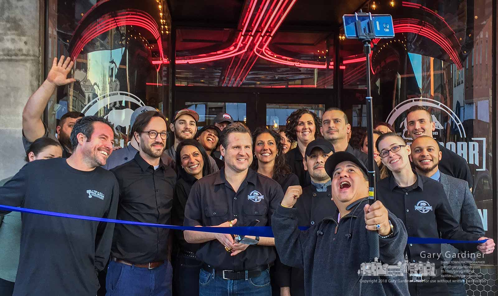 Barrel & Boar owner Stan Riley, center, with scissors, and his staff pose for a group selfie at the ribbon cutting for the restaurant at * North State Street in Westerville. My Final Photo for Jan. 19, 2018.