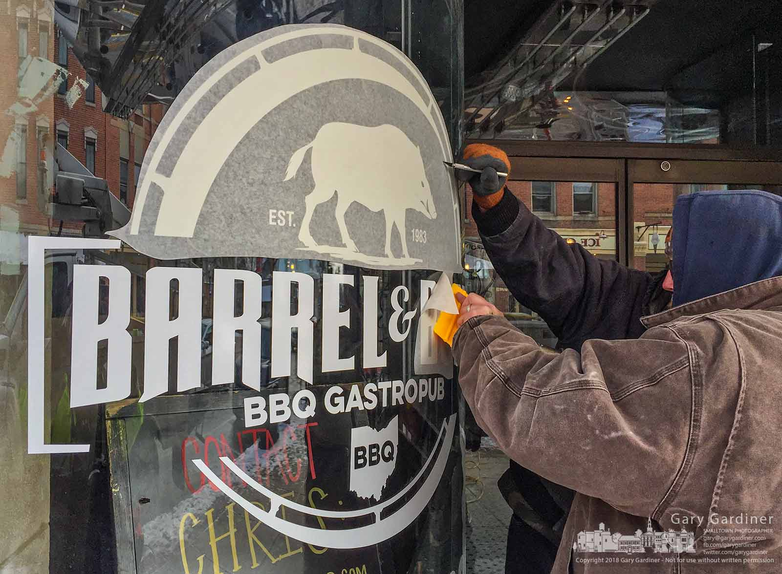 Sign makers install the Barrel & Boar restaurant logo on the curved windows at the front of 8 State as the new restaurant gets closer to opening in Uptown Westerville. My Final Photo for Jan. 5, 2017.