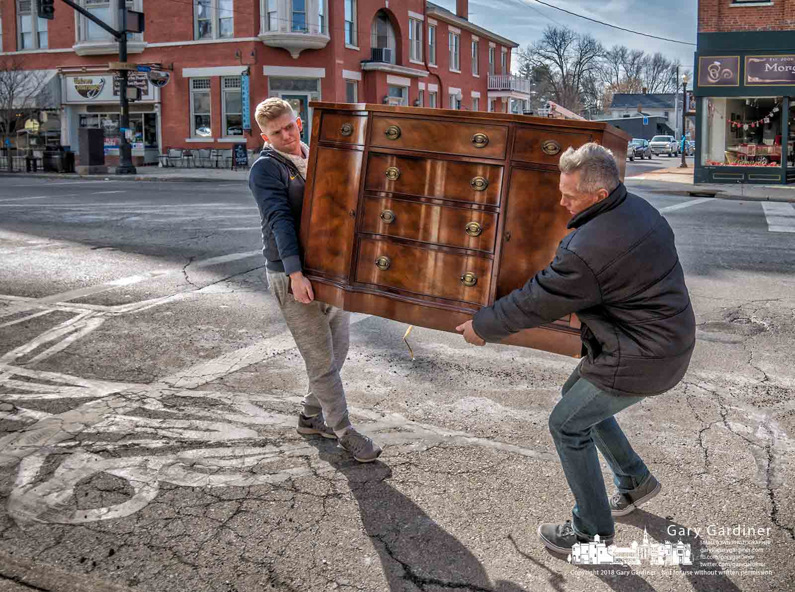 Pickers carry a newly acquired dresser into Edwin Loy Home in Uptown Westerville where it will be refurbished for resale. My Final Photo for Jan. 31, 2018.