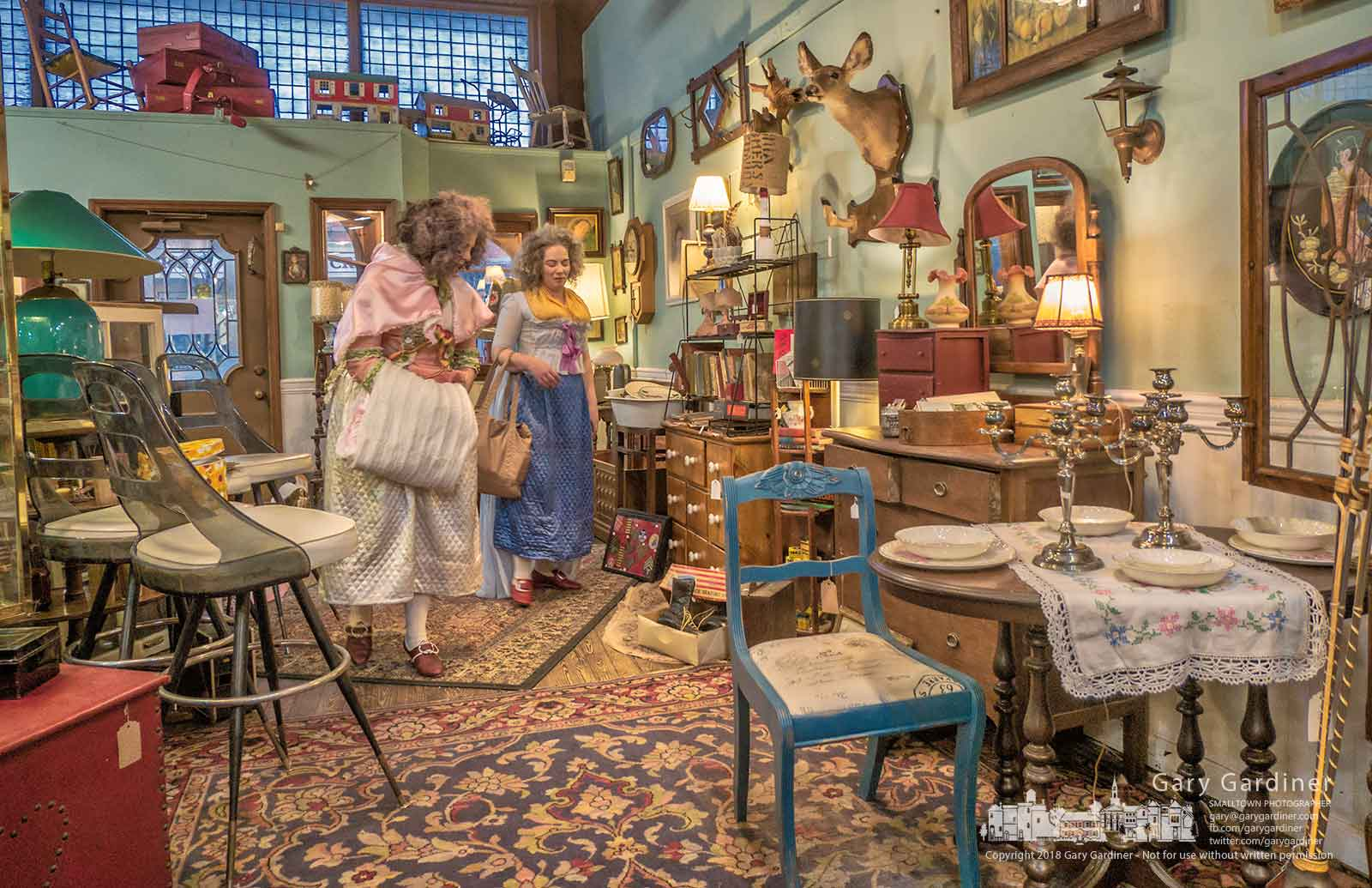 Ohio Historic Costumers Brittany Frederick, left, and Hayley Havener look through the collection in Westerville Antiques after attending a meeting of their costuming group in Uptown. My Final Photo for Jan. 27, 2018,