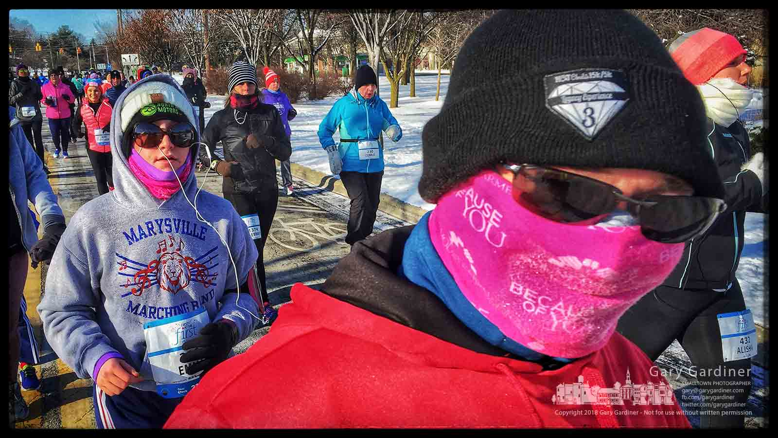 A runner navigates around the second turn in the First on the First 5K Run with runners beginning the race before noon when the temperature increased to eight degrees. My Final Photo for Jan. 1, 2018.