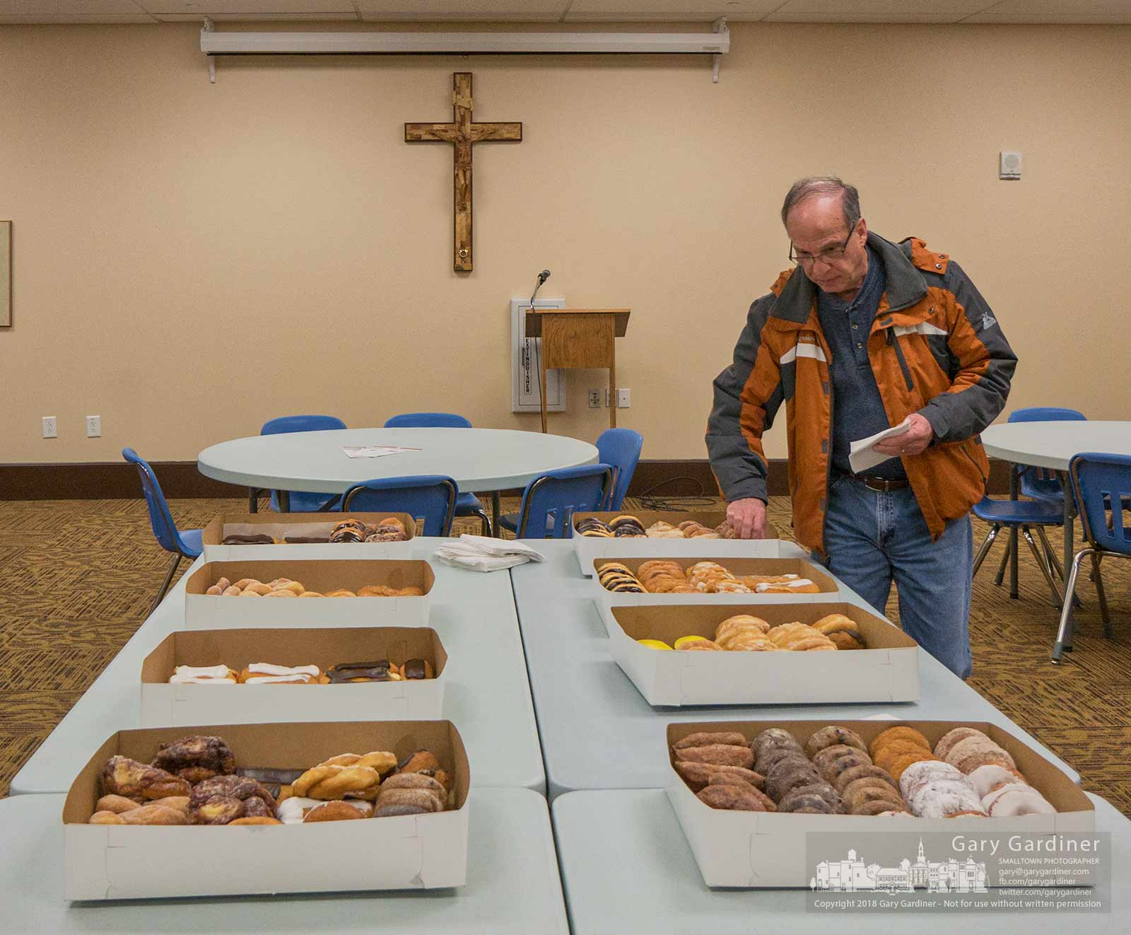 A parishioner walks around a table covered with donuts used as a church group's fundraiser after morning Mass at St. Paul Catholic Church in Westerville. My Final Photo for Jan. 7, 2018.