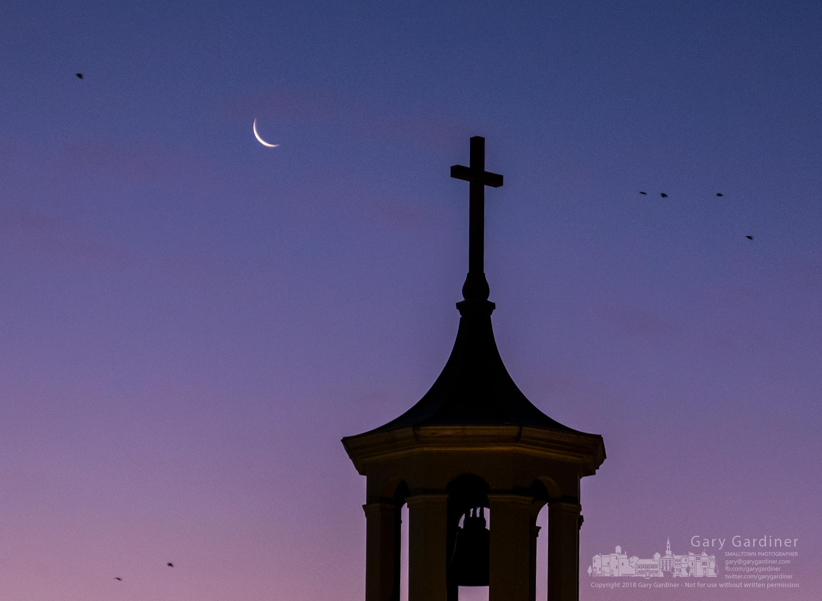 A crescent moon rises behind the old bell tower at St. Paul the Apostle Catholic Church early on Sunday morning. My Final Photo for Jan. 14, 2018.
