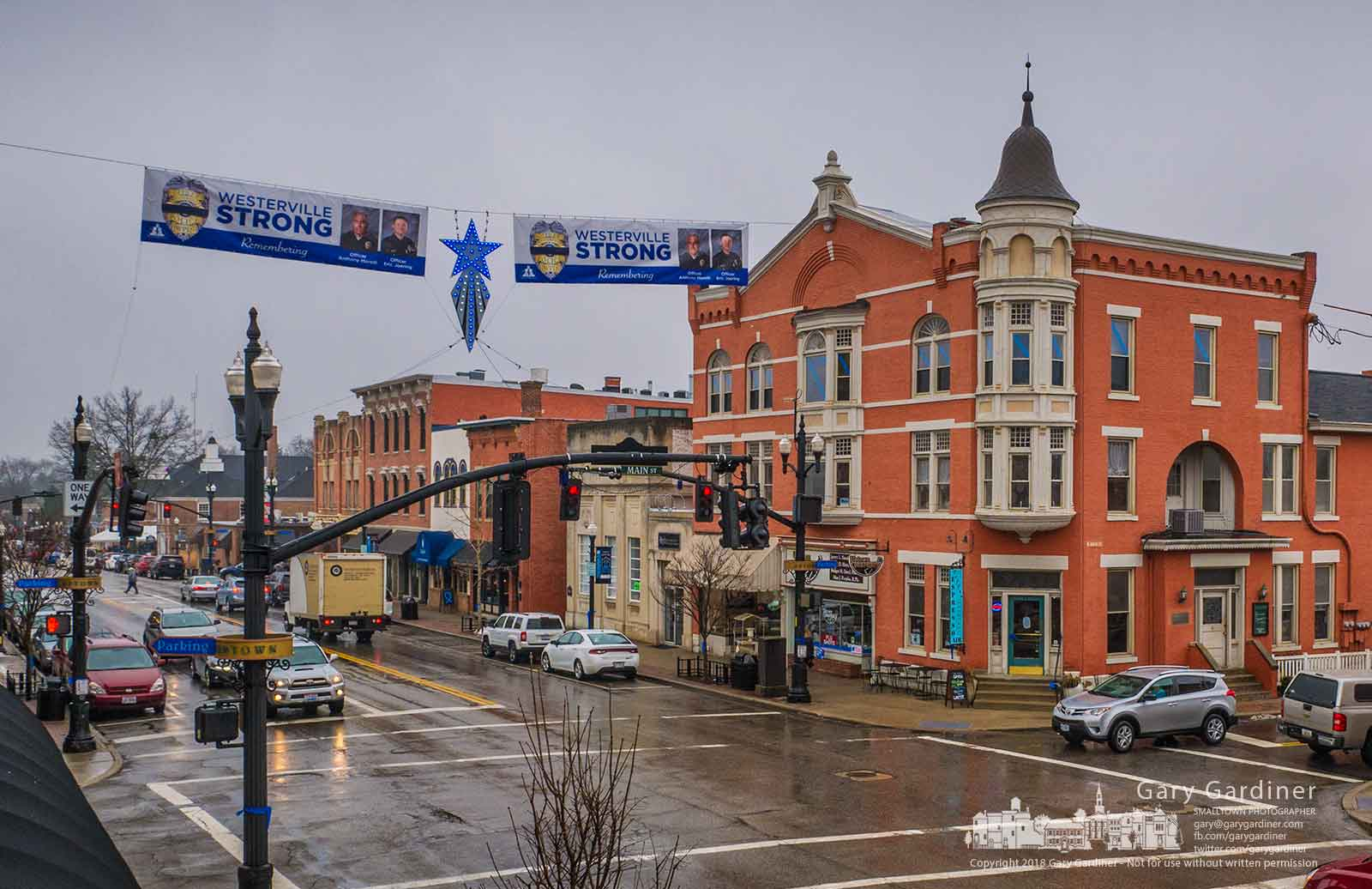 Banners honoring Westerville Police Officers Anthony Morelli and Eric Joering hang on either side of the Christmas Star lit with blue lights at State and Main Streets in Westerville. My FinalPhotofor Feb. 14, 2018.
