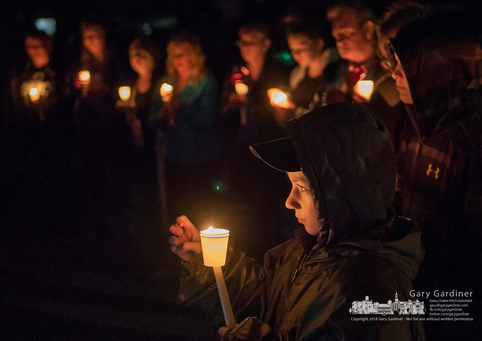 A boy listens at a candle-lit prayer vigil in the condominium complex where two Westerville police officers were killed responding to a dropped 911 call. My Final Photo for Feb. 15, 2018.