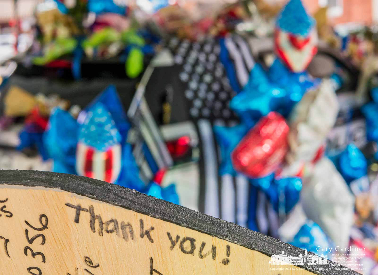 """A simple """"Thank you"""" is written on the backside of a badge-shaped placard at the memorial in front of city hall for two Westerville police officers who were killed answering a call last week. My Final Photo for Feb. 17, 2018."""
