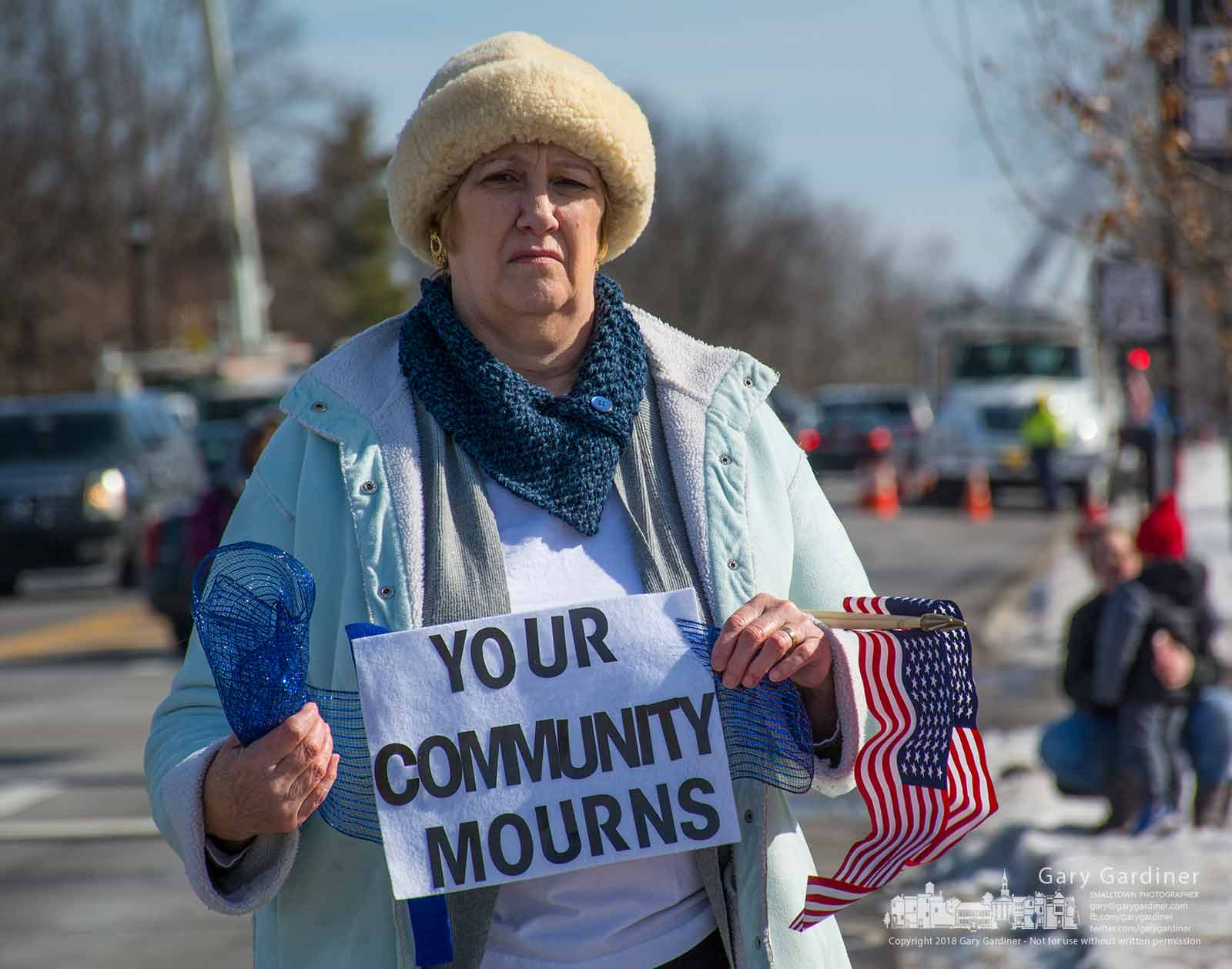 A woman stands away from the crowd of mourners gathered at Schrock and Otterbein as a police motorcade carrying the bodies of Westerville Police Officers Anthony Morelli and Eric Joering traveled to funeral homes in the city. My Final Photo for Feb. 12, 2018.