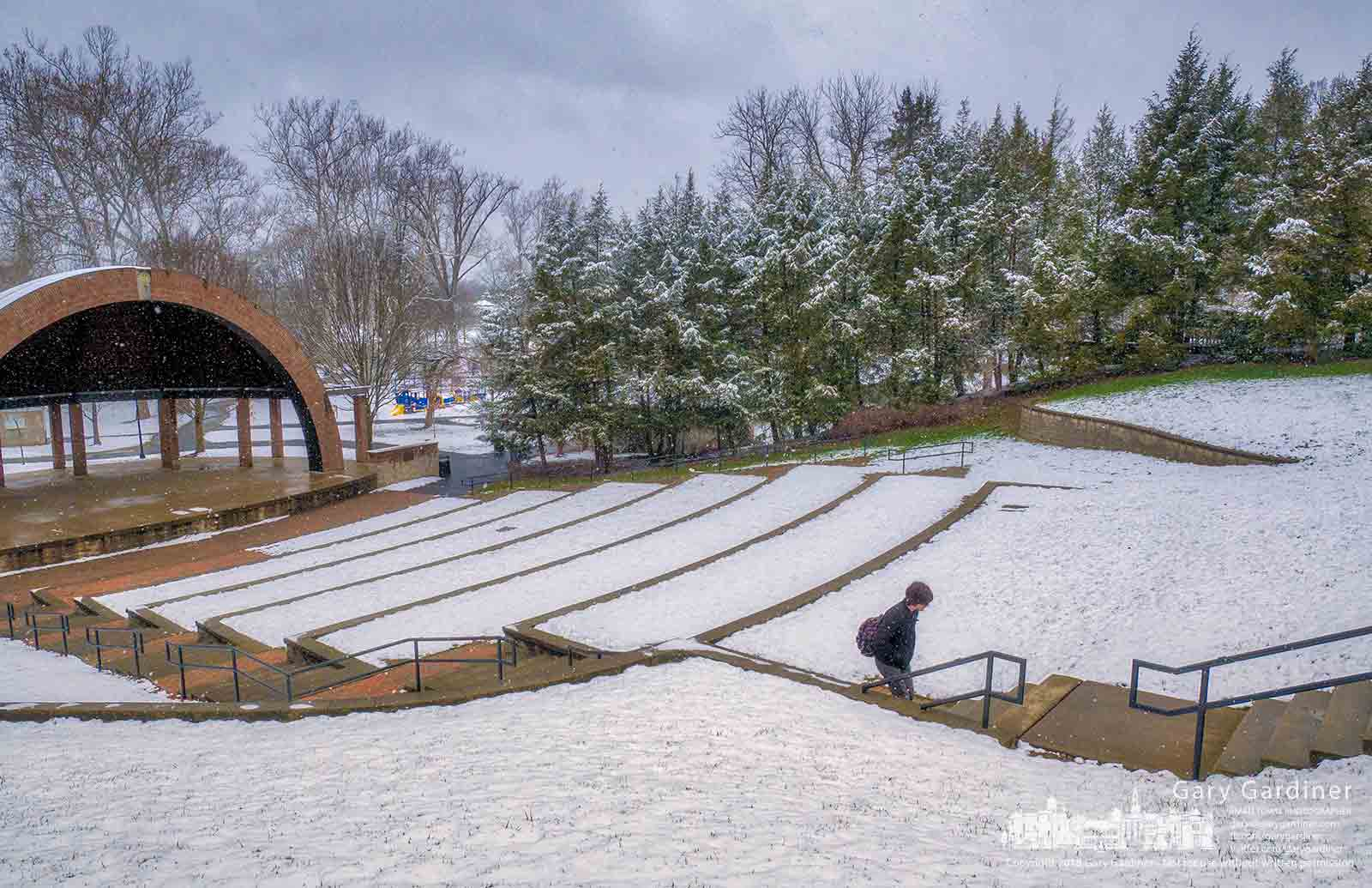 An Otterbein student walks across the snow-covered Alum Creek amphitheater on his way to a late afternoon class on the second day of Spring. My Final Photo for March 21, 2018.