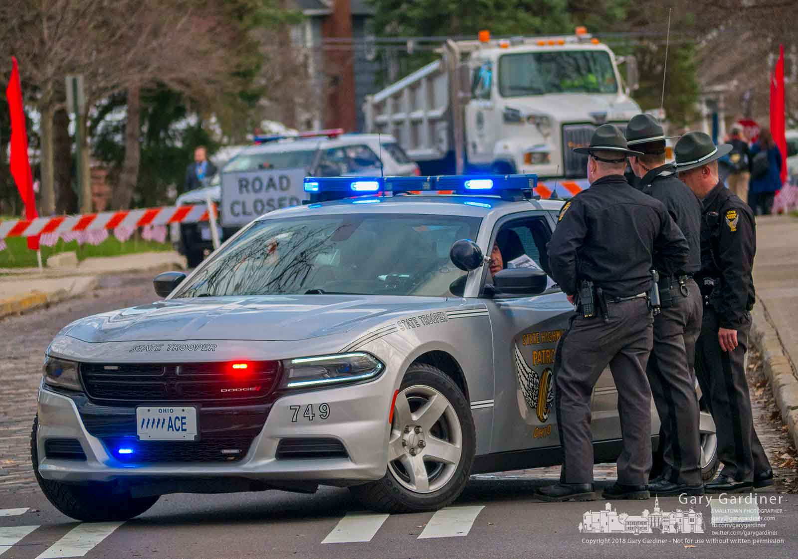 Ohio State Patrol troopers block Grove Street at Main Street as a security barrier near where Ohio Gov. John Kasich will give his final State of the State speech on the Otterbein University campus. My Final Photo for March 6, 2018.