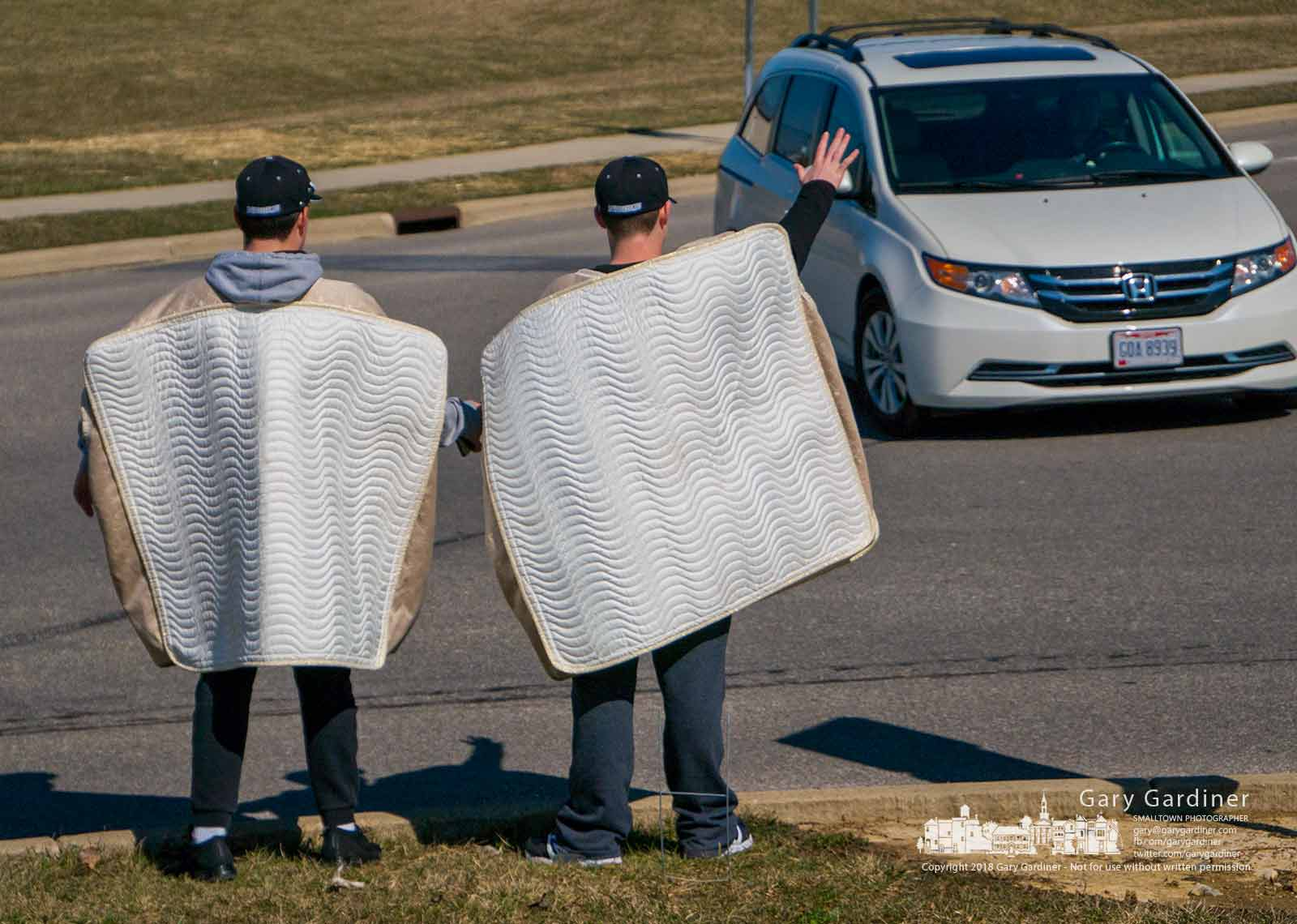 A pair of Westerville Central students wearing mattress covers stand at the entrance to the school to attract shoppers to the annual track and baseball fundraiser. My Final Photo for March 10, 2018.
