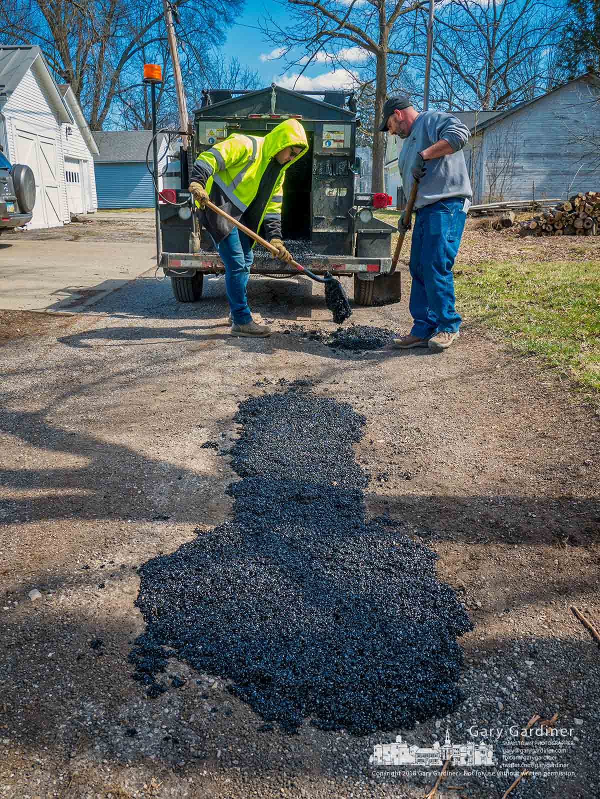 City workers shovel hot mix asphalt into potholes on North Alley off Vine Street. My Final Photo for March 15, 2018.