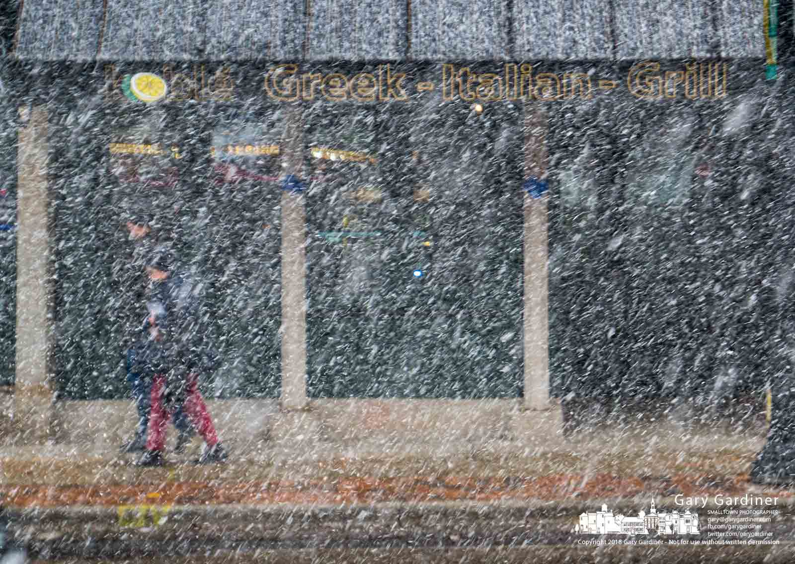 A strong afternoon snow squall obscures the view across State Steet where shoppers hurry to find shelter in stores and their vehicles. My Final Photo for March 7, 2018.