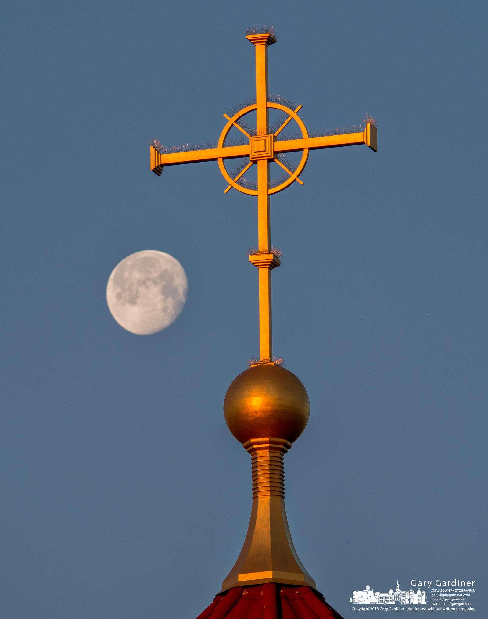 The early morning moon sets behind the cross at the top of St. Paul the Apostle Catholic Church in Westerville, Ohio. My Final Photo for March 4, 2018.