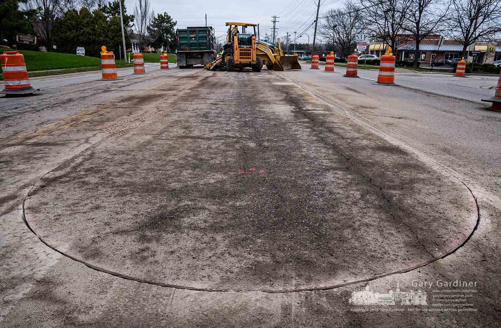 An arced saw cut in the middle of Cleveland Avenue near Main Street marks the end of a new median being installed this week that will remove left turns along that section of the roadway. My Final Photo for April 9, 2018.