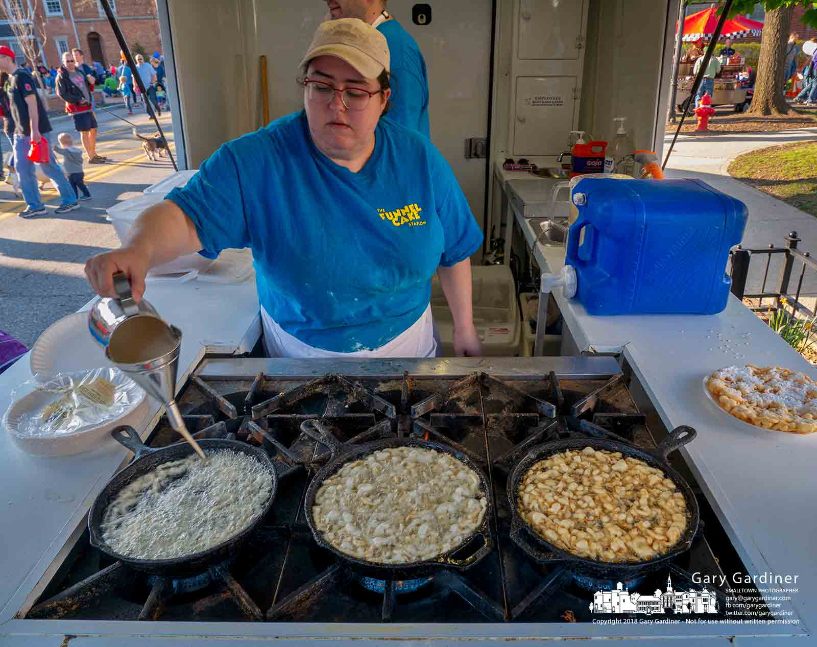 A trio of fried funnel cakes fills the cast irons skillets of a food vendor at the first Fourth Friday of the summer in Westerville. My Final Photo for April 27, 2018.