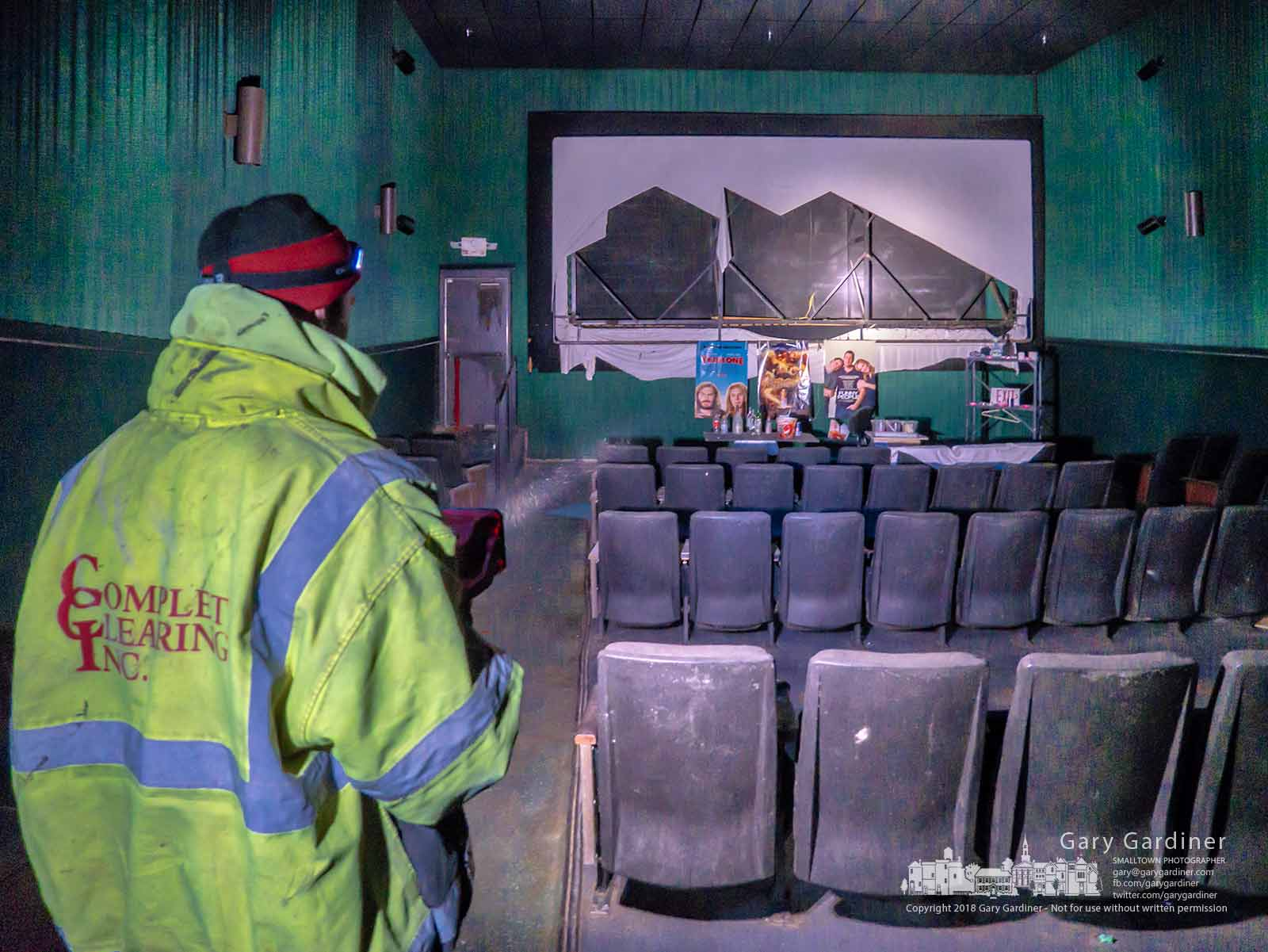A demolition worker points out where trespassers had organized a meeting room in one of the abandoned theaters at the Hollywood Studio Theaters in Glengary Shopping Center. My Final Photo for April 17, 2018.
