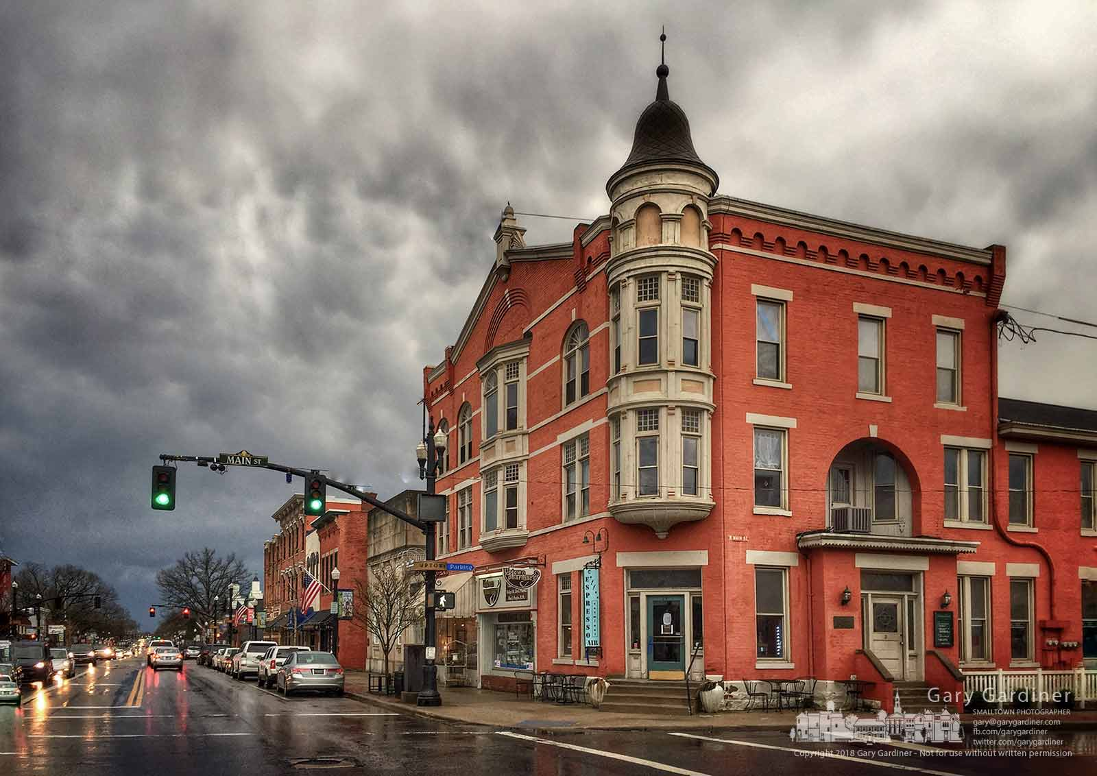 An afternoon storm darkens the sky over the Holmes Hotel in Uptown Westerville as a Spring storm brings rain and winds to central Ohio. My Final Photo for April 3, 2018.