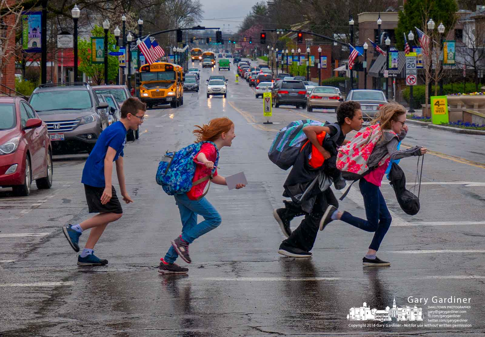 Trailed by their instructor, a small group of dancers dash across State Street during a brief lull in afternoon rain. My Final Photo for April 24, 2018.