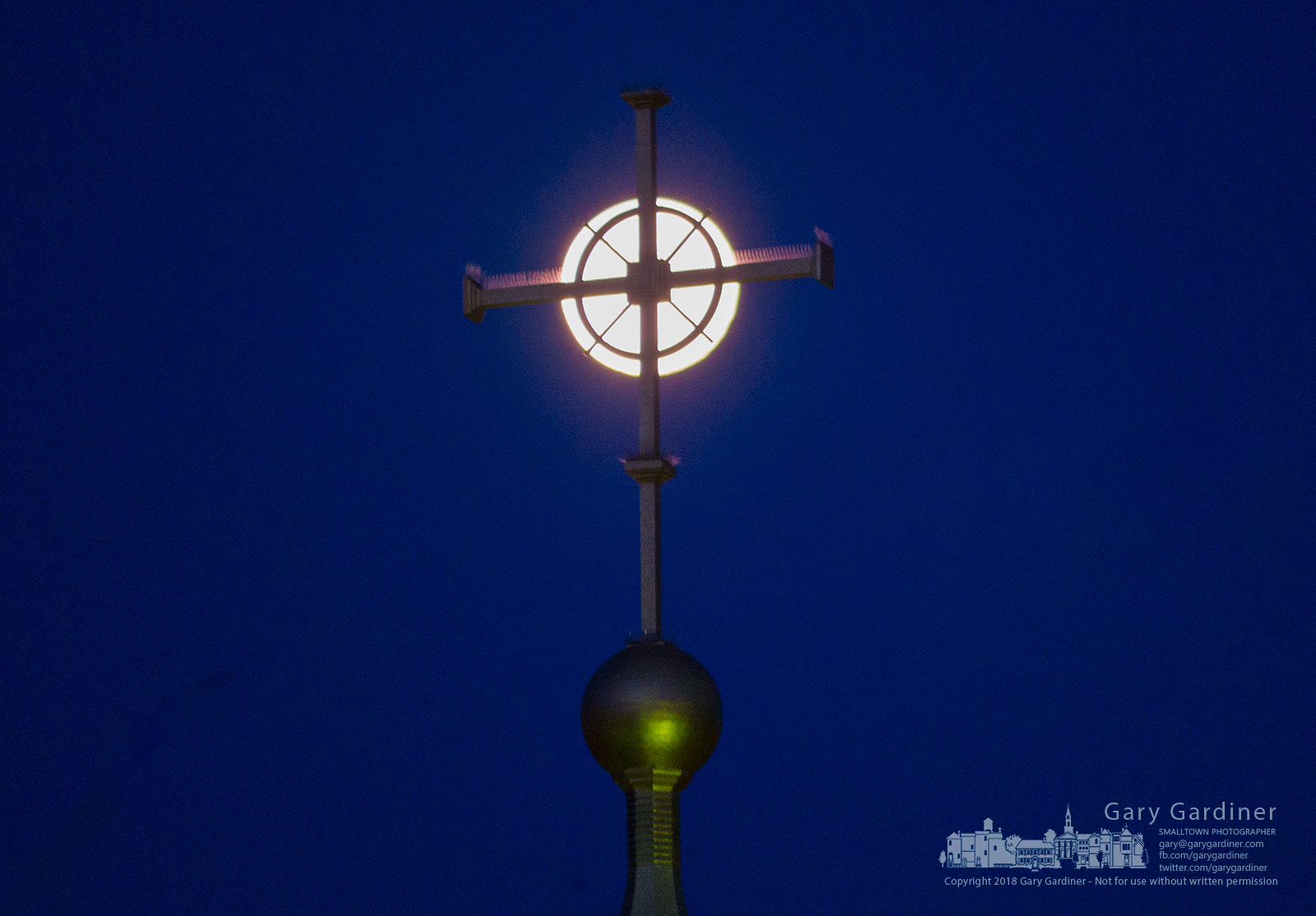 The morning moon slides behind the cross at the top of St. Paul the Apostle Catholic Church as parishioners arrive for the 7 a.m. Easter morning Mass. My Final Photo for April 1, 2018.