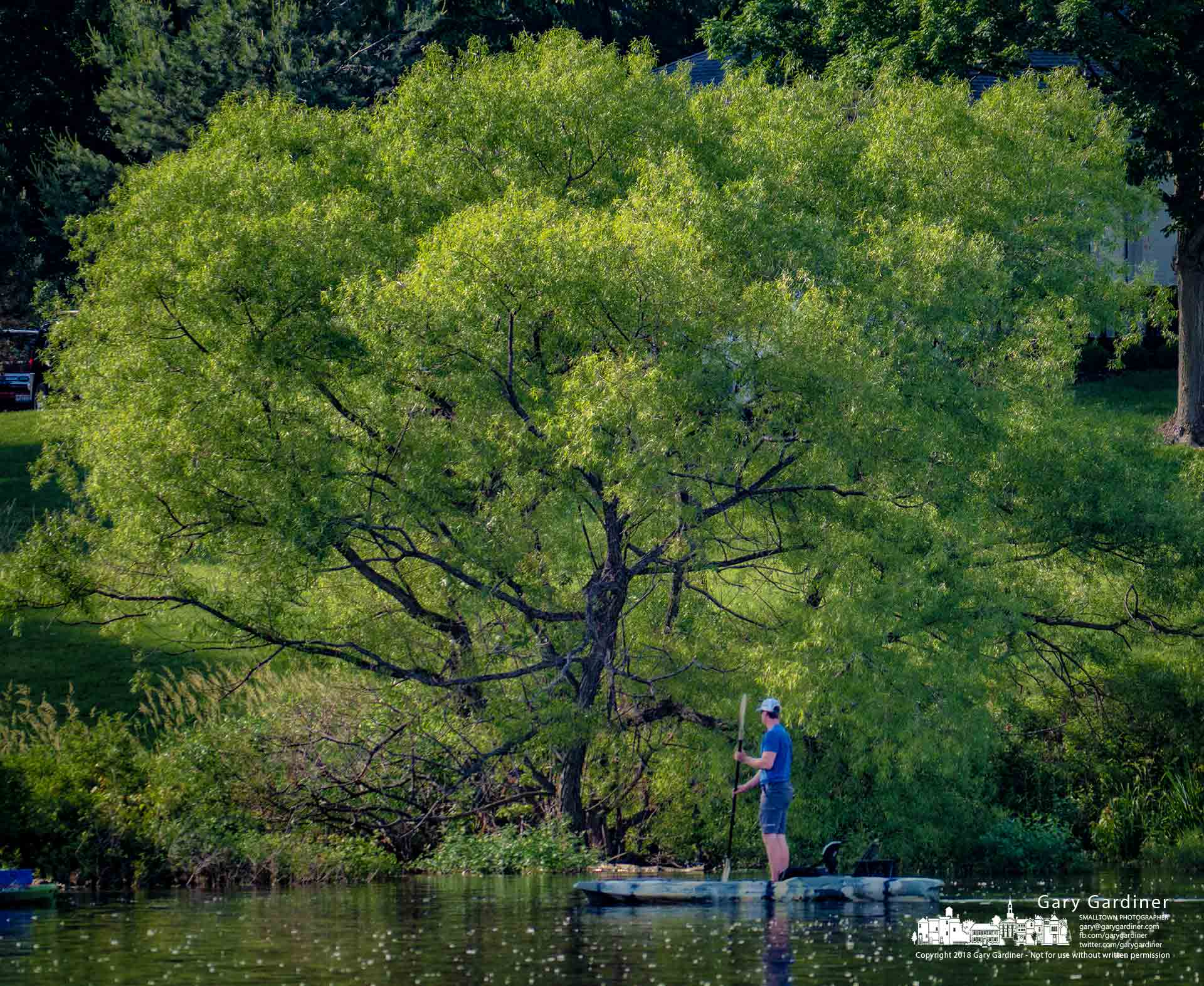 A kayaking angler navigates his way along the shoreline of Hoover Reservoir. My Final Photo for May 27, 2018,