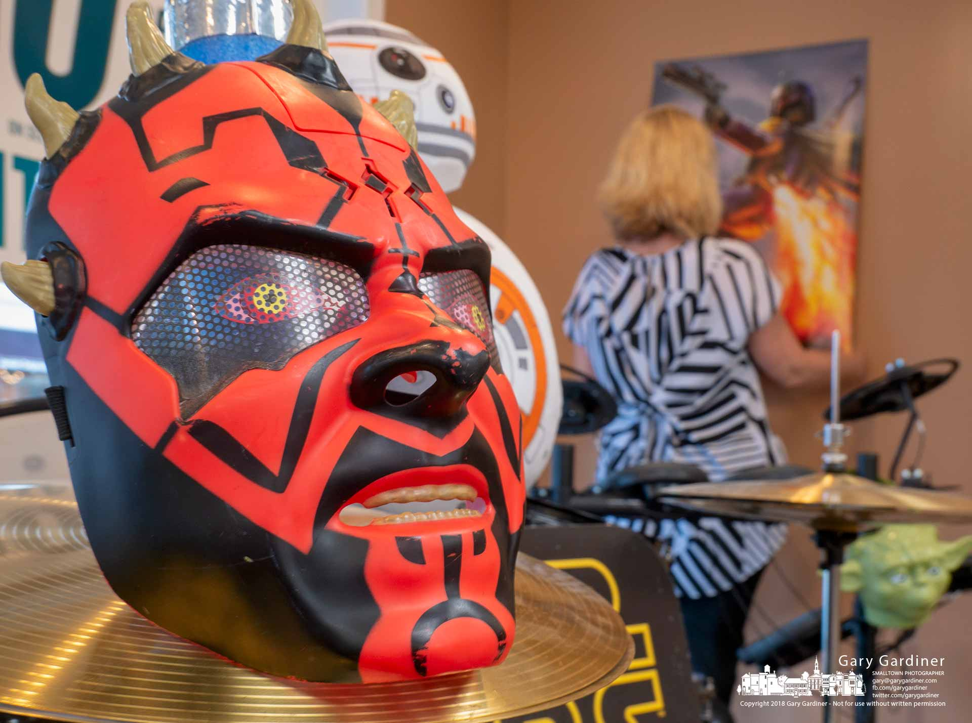 """A mask of Star Wars' Darth Maul sits on a set of cymbals in the front window of Music and Arts in Uptown Westerville where a """"May The 4th Be With You"""" celebration on Friday highlights Star Wars and the play on words the date brings. My Final Photo for May 3, 2018."""