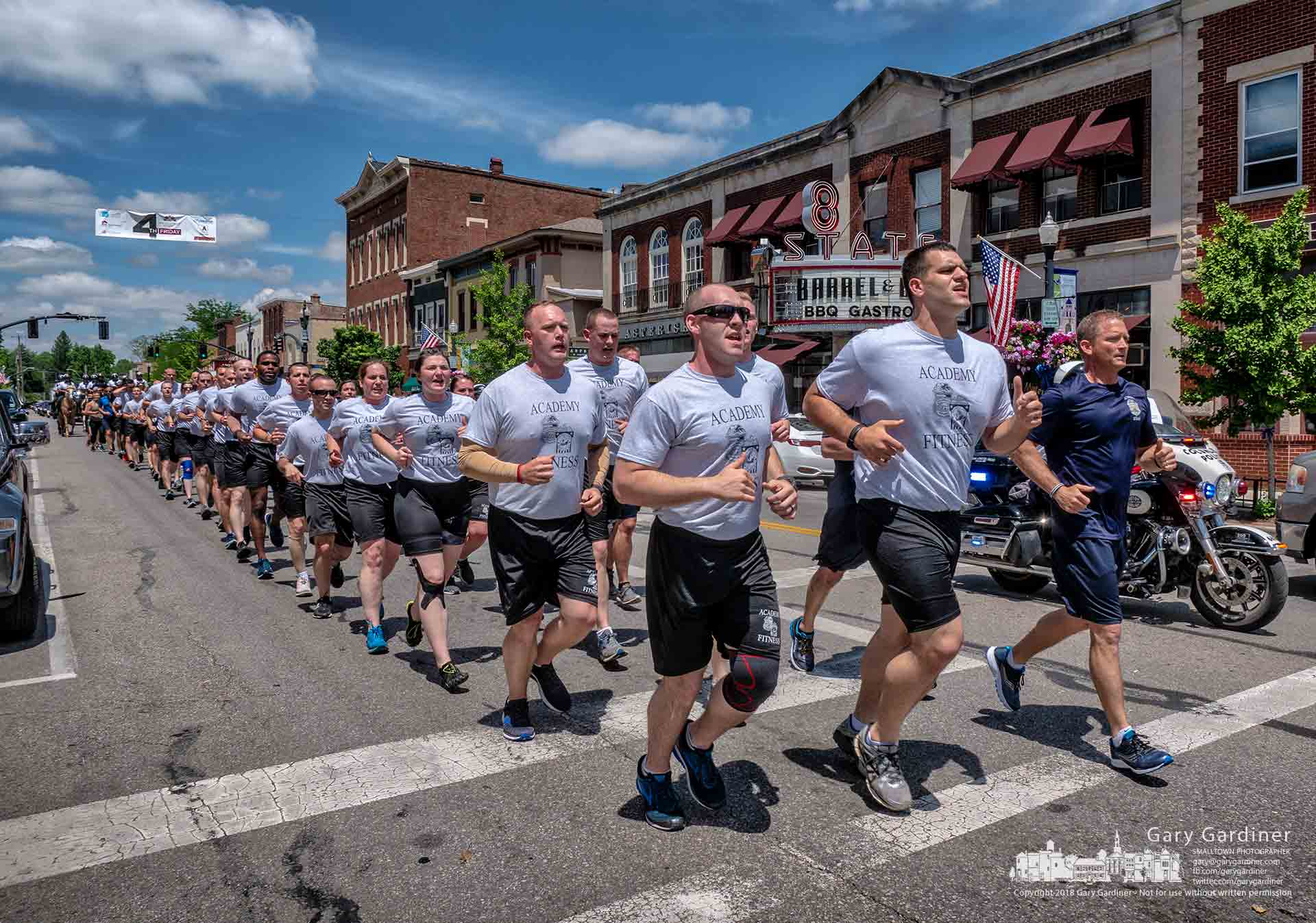 Shoppers and drivers were treated to a rare sight in Uptown Westerville as the Columbus Police Academy Fun Run navigated its way along State Steet on the first leg of the run. My Final Photo for May 23, 2018.