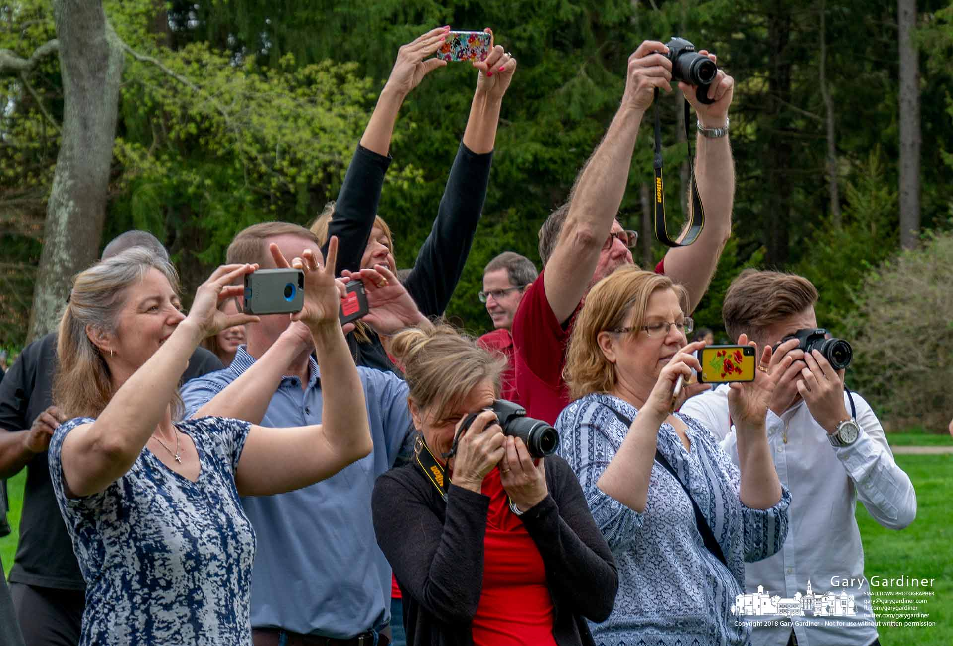 Parents use digital cameras and smartphones to photographtheir children posing in Inniswood Gardens before going to spring prom. My Final Photo for May 5, 2018.