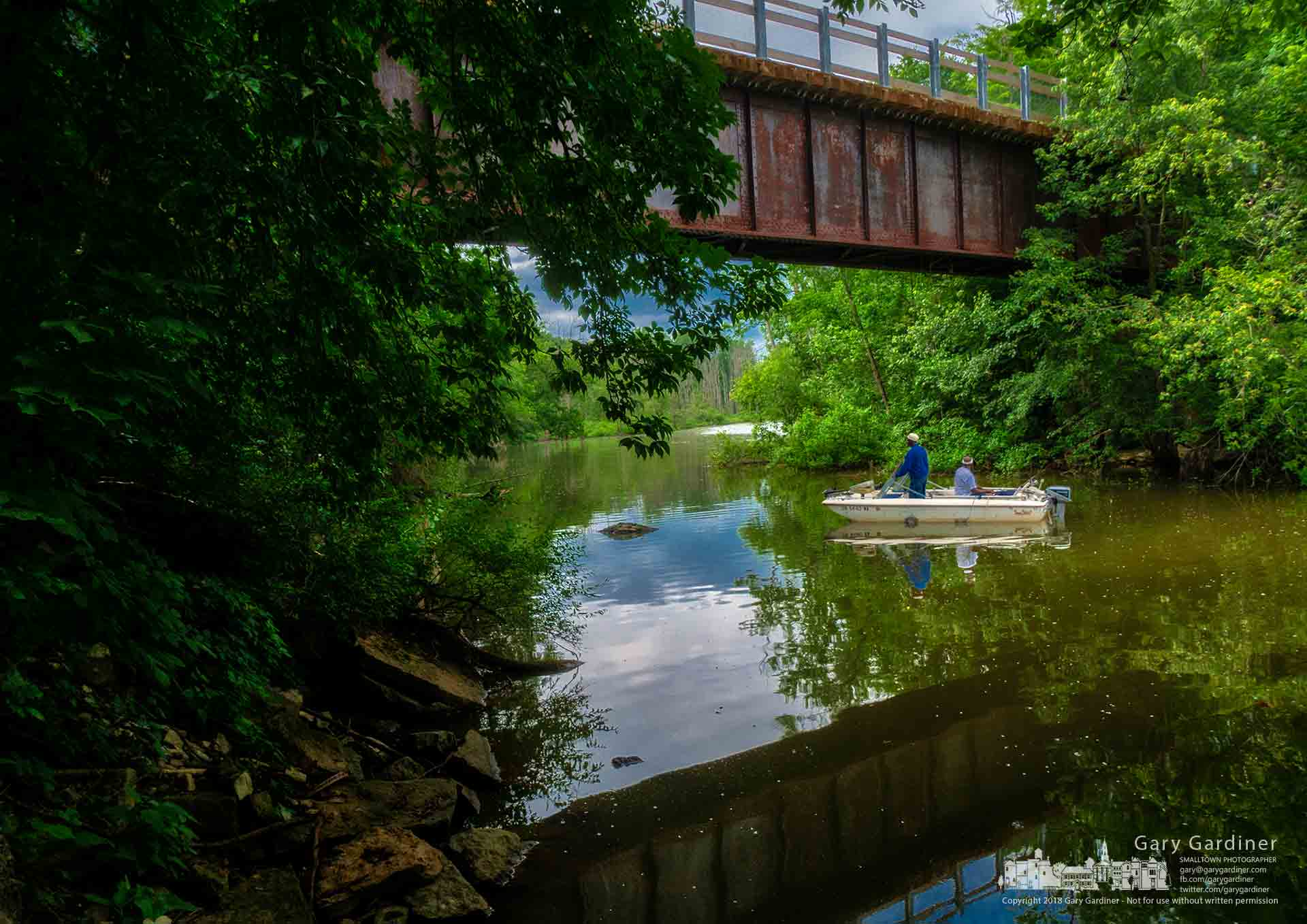 A pair of fisherman tries their luck fishing Big Walnut Creek beneath the bridge spanning what used to be a railroad overpass in Galena. My Final Photo for June 10, 2018.