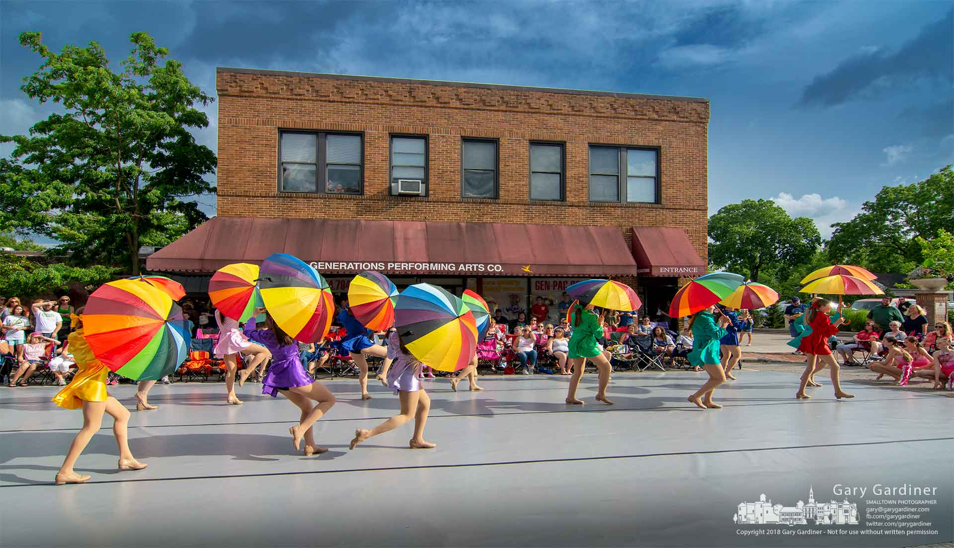 Dancers using rainbow-colored umbrellas begin an evening of dance in the street at June's Fourth Friday celebration in Uptown Westerville. My Final Photo for June 22, 2018.